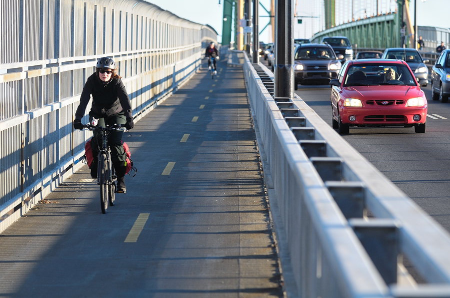 A person crosses the Macdonald Bridge bicycle lane