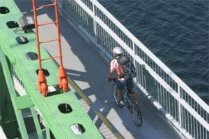 A cyclist crosses the Macdonald Bridge Bicycle Lane